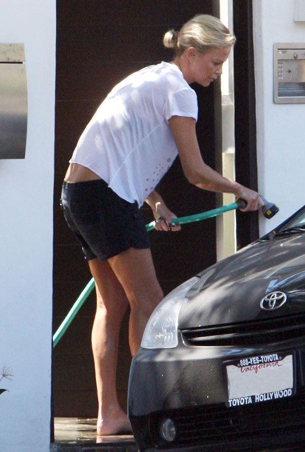 Charlize Theron washing her car (6 pics)