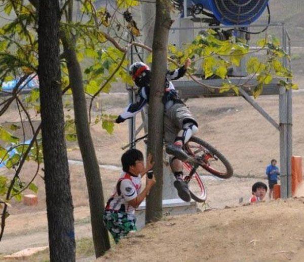 Biker Hits Spectator (4 pics)