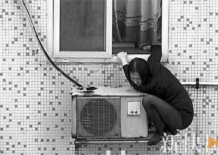 Suicide Girl Sitting on an Air Conditioner (8 pics)