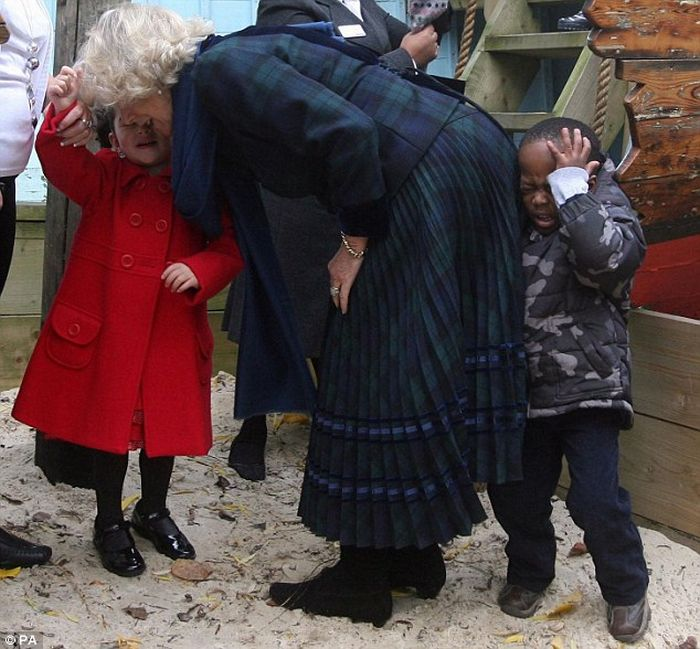 Camilla Gives a Little Boy a Royal Bump (3 pics)