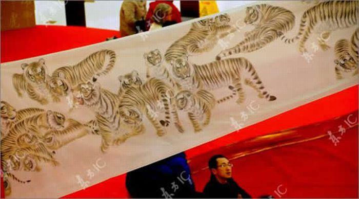 Most Tigers on a Scroll (10 pics)
