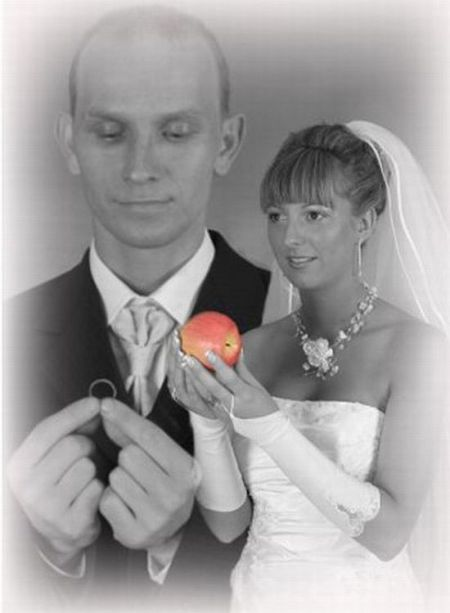 awkward wedding photo of bride holding an apple