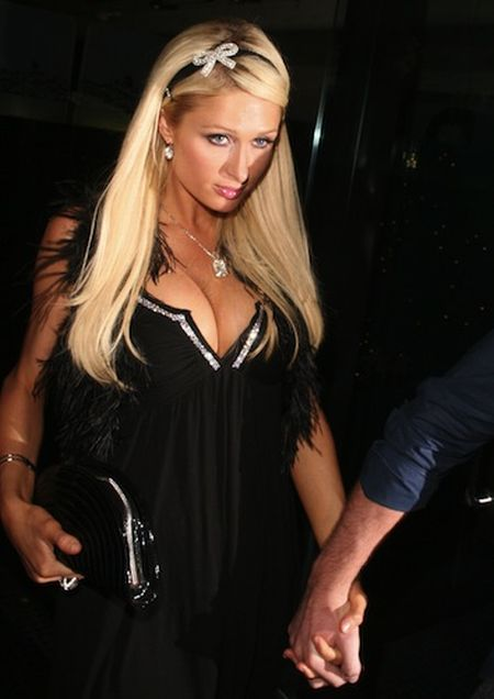 Paris Hilton Transfixed by Own Boobs (19 pics)