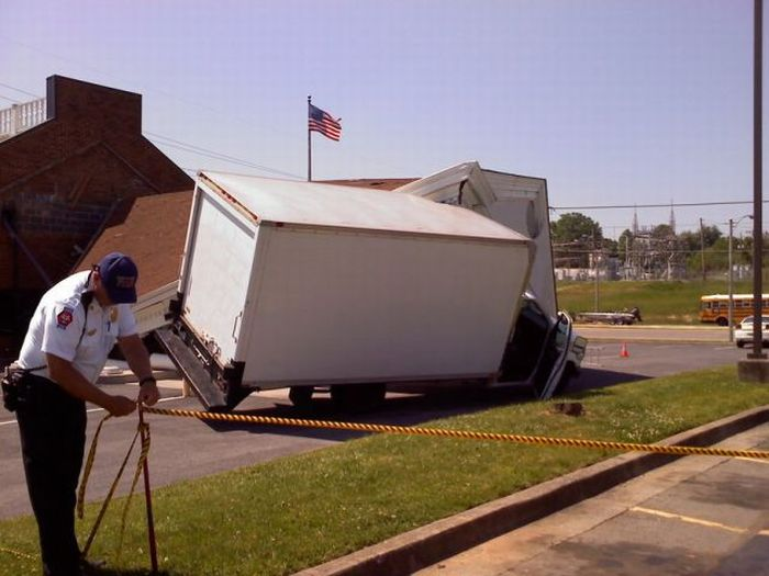 Truck Driver Destroys a Bank (9 pics)