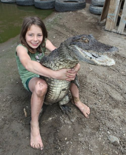 A 9-year-old Alligator Wrestler (7 pics)