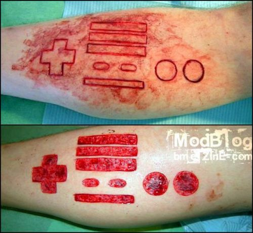 Insane Scarification Tattoos (25 pics)