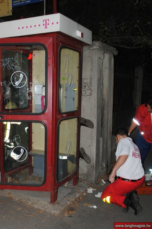 Drunk Man Trapped Upside Down Behind a Booth (11 pics)