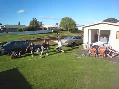 Four Grown Men Jump Through a Hula Hoop
