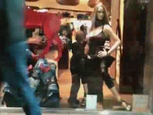 Kid Playing with a Mannequin
