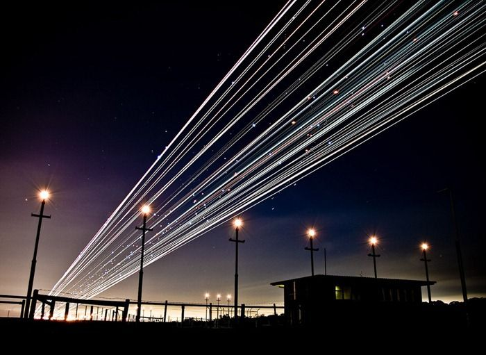Long Exposure Shots of Airline Takeoffs and Landings (14 pics)