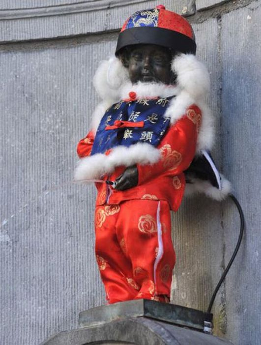 The Outfits Mannequin Pis in Brussels Wears (13 pics)