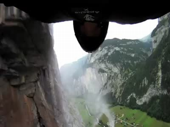 Wingsuit Jump Through Waterfall