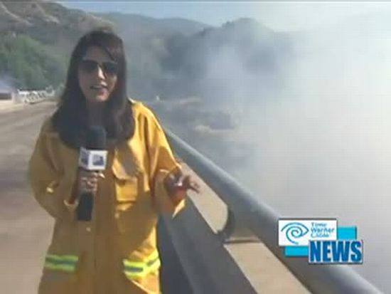 Helicopter Dumps Water Load on Reporter