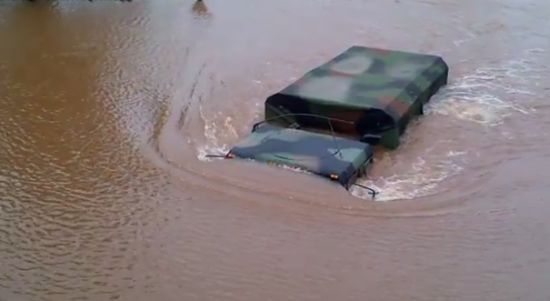 National Guard Attempts To Drive Through Flood (video)