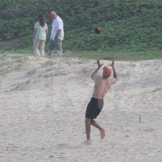 President Obama Plays Football in Hawaii (15 pics)
