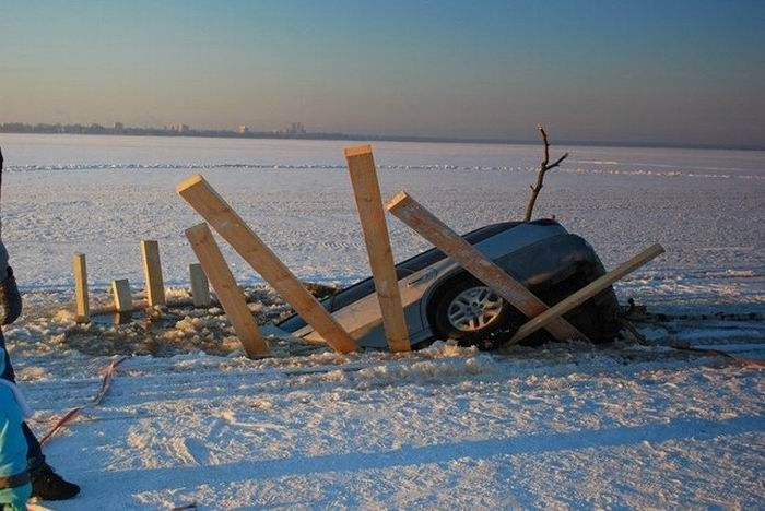 Frozen Lake Driving Gone Bad (4 pics)