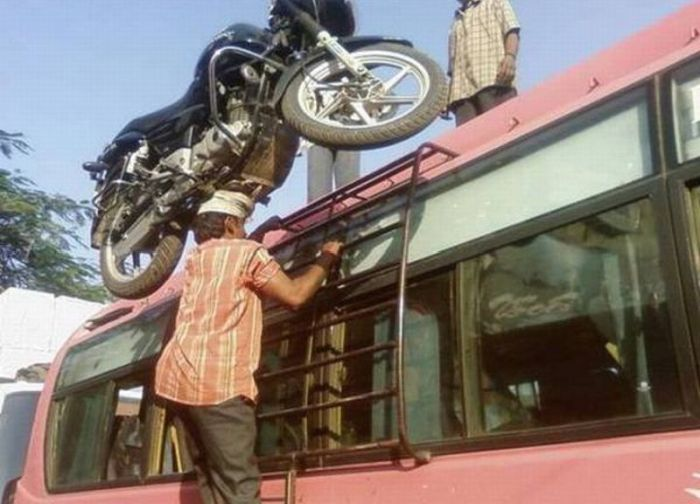 Indian Man with  Motorbike on His Head (4 pics)