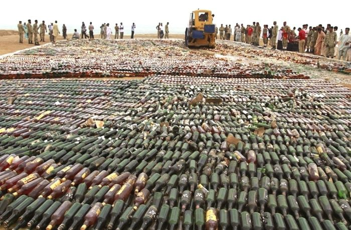 Liquor Bottles Smashed By A Steamroller (9 pics)