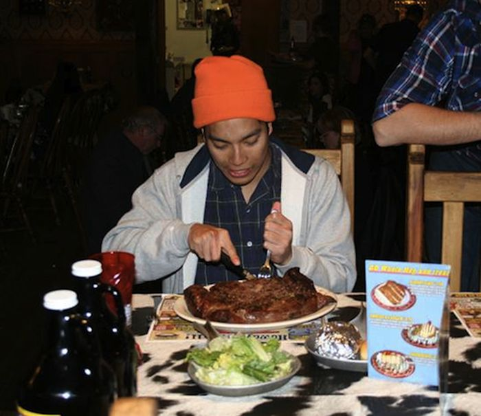 People Consuming Large Things (15 pics)