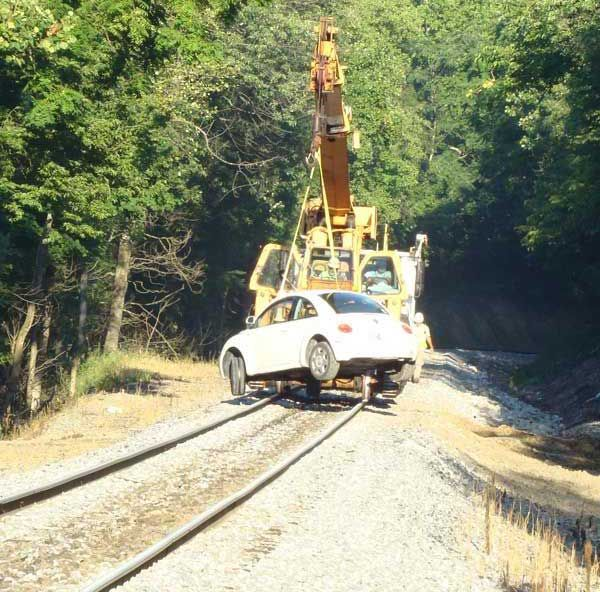 Woman Arrested After Driving Car Down Railway Tracks (3 pics)
