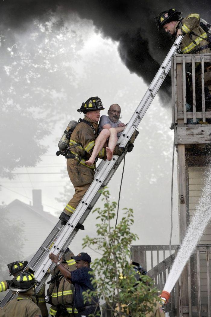 Firemen Rescue A Man 5 Pics