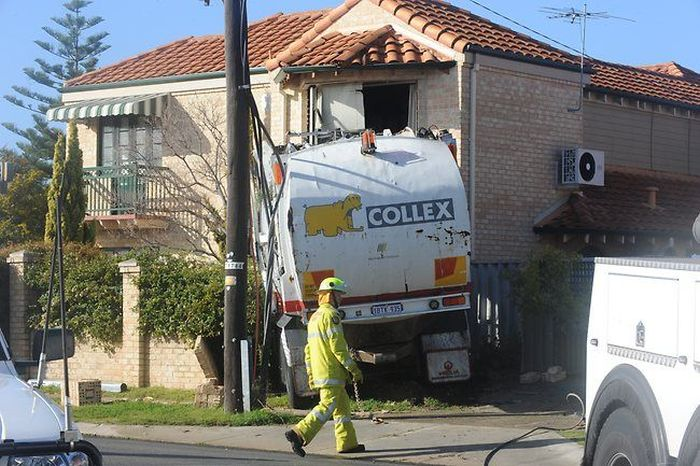 Garbage Truck Trashes House in Australia (20 pics)