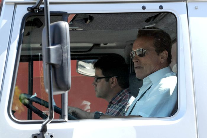 Arnold Schwarzenegger Riding a Monster Truck (4 pics)