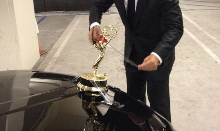 Tom Hanks Uses Emmy as Hood Ornament (3 pics)