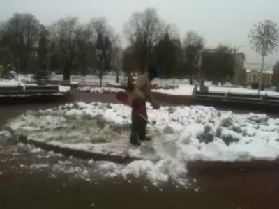 Cleaning The Snow With a Grass Cutter