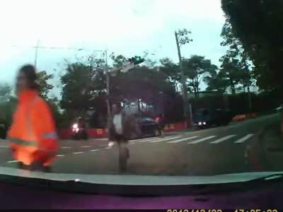 Stupid Pedestrian Jumps Under a Car