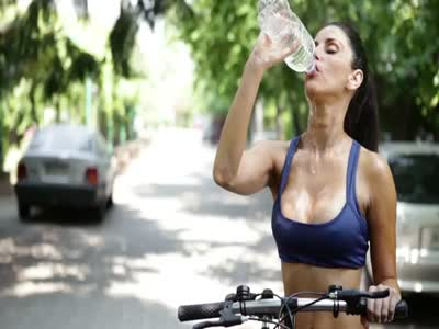 Sexy Girl on Bike is Thirsty