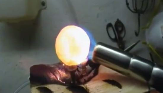 Incandescent Nickel Ball vs Ice