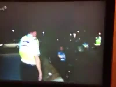 Police Officer Trolling a Drunk Driver