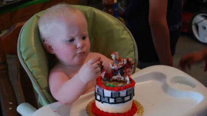 Eats His First Birthday Cake 6 pics