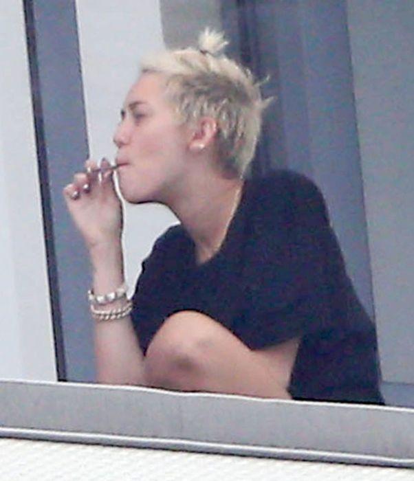 Miley Cyrus Smoking A Joint (11 pics)
