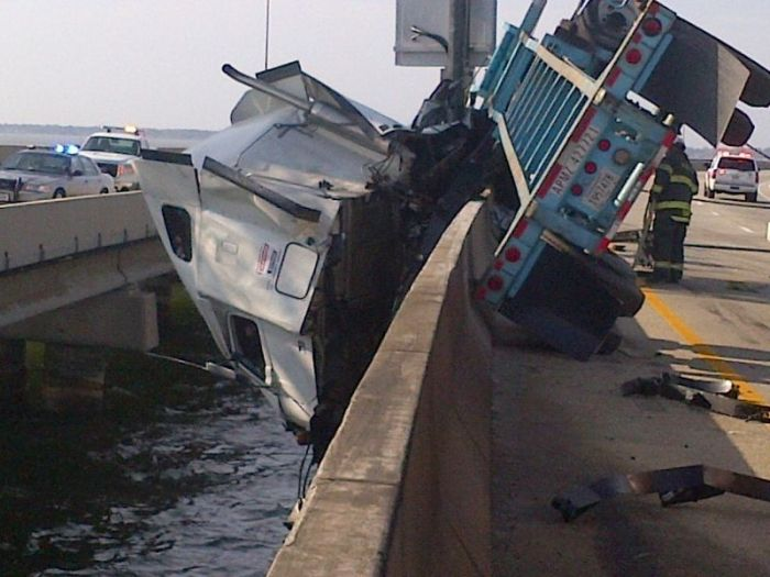 Truck Driver Rescued From Overturned Tractor-Trailer (4 pics)