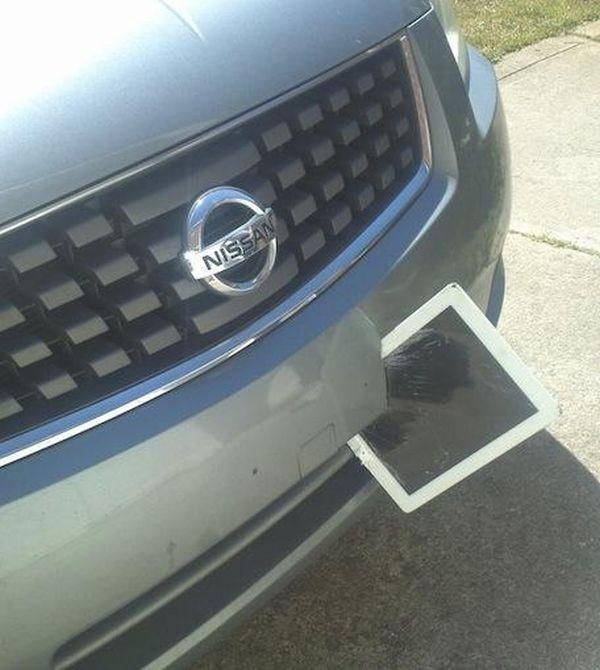 Ipad Stuck in Car Bumper (6 pics)