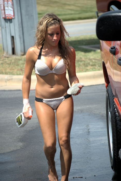 amateur washing car in a bikini