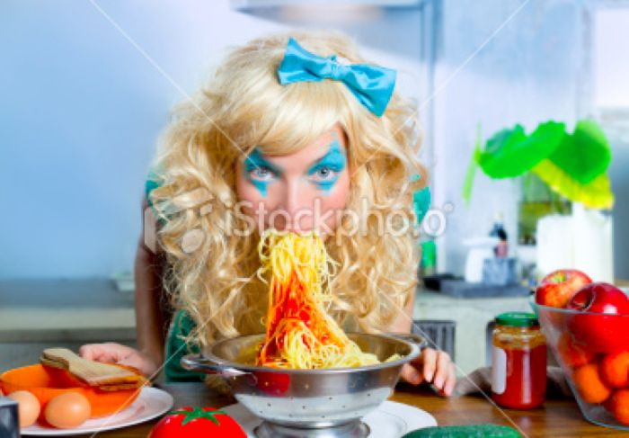 Women Eating Pasta Stock Photos (25 pics)