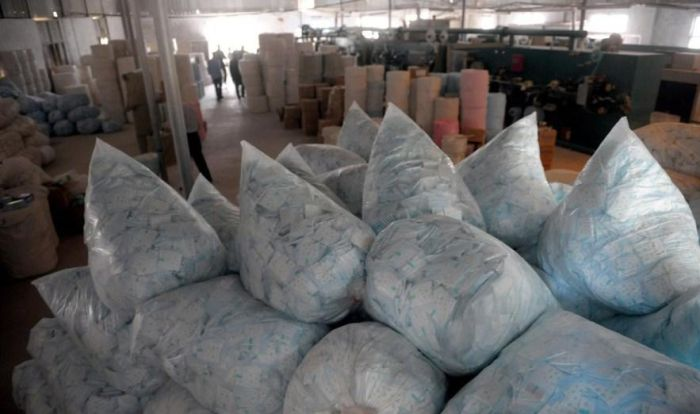 Illegal Production of Pads in China (7 pics)