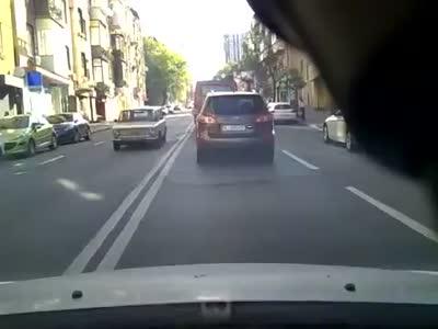 Motorcycle Driver Crashes Into a Car Door