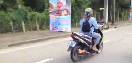 Parrot Escorting its Master on Scooter