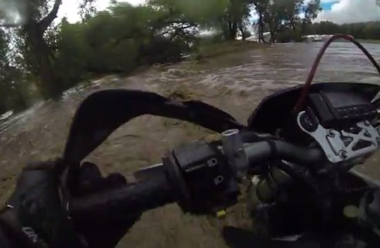 Motorcyclist Trying To Run Away From The Flood
