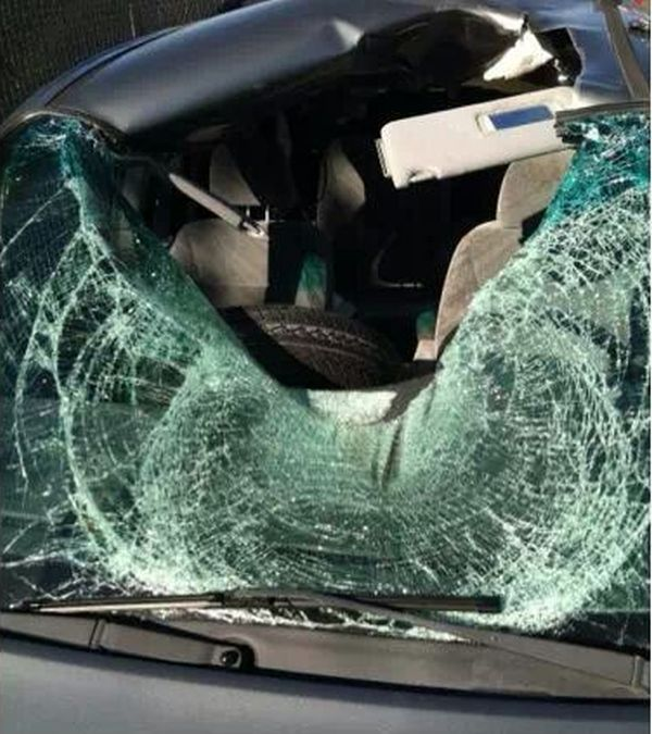 Tire Flies Into a Car's Windshield (3 pics)