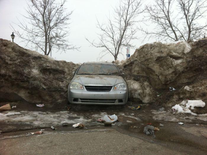 Car Frozen In Snowbank (3 pics)