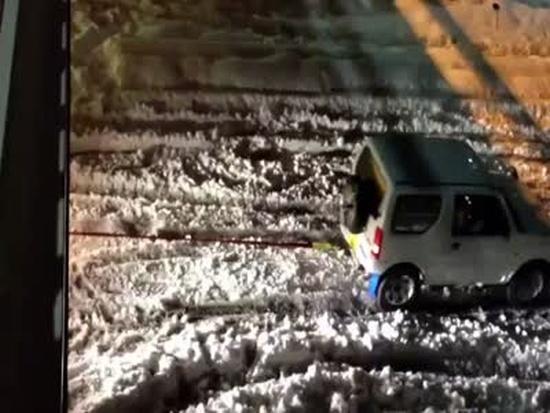 Miniature Suzuki SUV WIN on Snowy Road