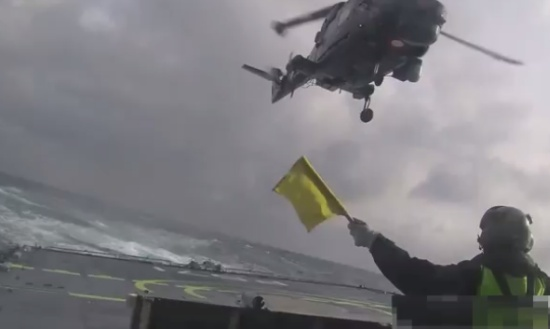 Helicopter Landing on Ship During the Storm
