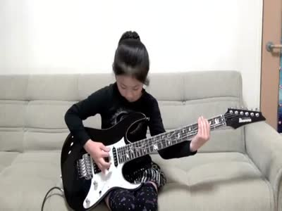 8-Years-Old Girl Playing Guitar