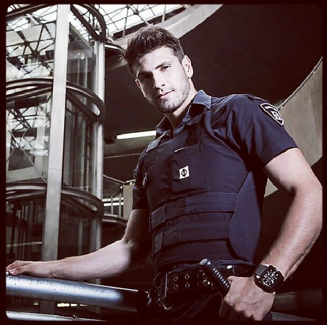 The Hottest Subway Security Guard (18 pics)