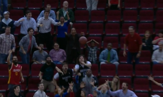 Basketball Fan Gives the Ball to a Boy